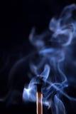 Extinguished match with smoke on black background Royalty Free Stock Image