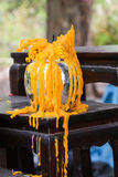 Extinguished yellow candle Stock Images