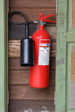 Extinguisher. Red extinguisher hang on wood wall Stock Images