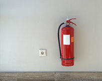 Extinguisher. Fire extinguisher protectuion device at wall Stock Photo