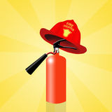 Extinguisher with firefighter hat Royalty Free Stock Photo