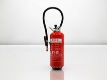 Extinguisher on white stock photos