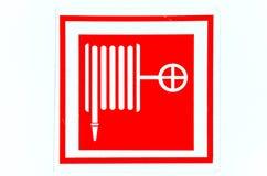 Extinguishing a fire hose symbol Stock Photos