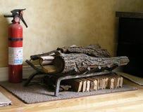 Extintor e madeira de incêndio Fotos de Stock Royalty Free