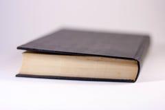 Extrémité de livres sur un fond blanc Photographie stock