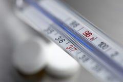 Extrémité proche vers le haut du thermomètre Photographie stock