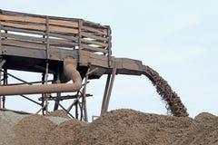 Extração da areia para a produção Imagens de Stock