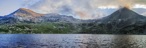 Extra high resolution detailed landscape panorama of Retezat. National Park mountains in South Carpatians, Transylvania, Romania, Europe. Small lake with blue Royalty Free Stock Images