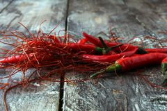 Extra hot red chili pepper strings, threads on white background.  stock photos