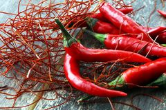 Extra hot red chili pepper strings, threads on white background.  stock photography