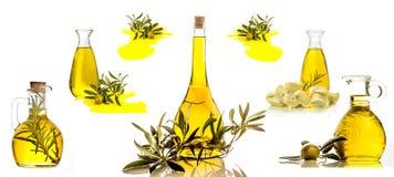 Extra jungfruliga isolerade olivoljaflaskor Royaltyfri Fotografi