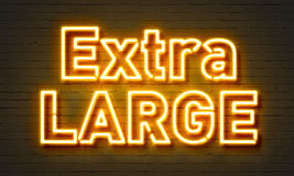 Extra large neon sign on brick wall background. Royalty Free Stock Images