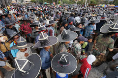 Extra large sombreros worn during Inti Raymi in Cotacachi Ecuado. June 29, 2017 Cotacachi, Ecuador: indigenous men wearing extra large sombreros dancing in  the Royalty Free Stock Image