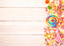 Extra large swirl colored sucker by gummy candy Royalty Free Stock Images