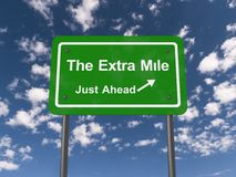 The extra mile just ahead road sign. With blue sky and cloudscape background royalty free illustration