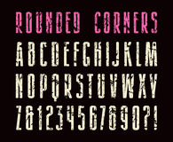 Extra narrow sanserif font with rounded corners. Letters with shabby texture. Print on black background Royalty Free Stock Image