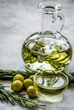 Oil in carafe with spices and olive on stone background. Extra oil in carafe with spices and fresh olive on stone desk background stock photos