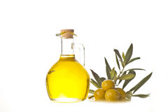 Extra olive oil bottle and olives. With leaves isolated on a white background Stock Image