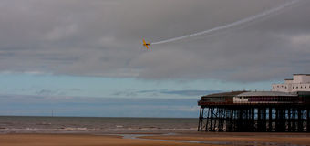 Extra 260 over Blackpool Pier Stock Image