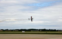 Extra 330SC Stunt Plane. Performing a low level flyby  with smoke Stock Photo
