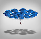 Extra Security. Concept as a wide group of blue umbrellas connected together as one umbrella as a symbol of supplemental full protection Stock Image