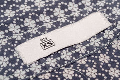 Extra Small Size. Macro Photo Of A Clothing Label Showing Size Xs (Extra Small Royalty Free Stock Photography