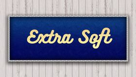 EXTRA SOFT handwritten on blue leather pattern painting hanging. On wooden wall. Illustration royalty free illustration