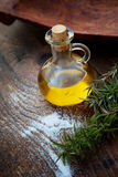 Extra virgin Olive oil. Extra virgin healthy Olive oil with fresh rosemary on rustic wooden background Stock Photography