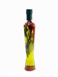 Extra Virgin Olive Oil. With herbs in a bottle royalty free stock photography