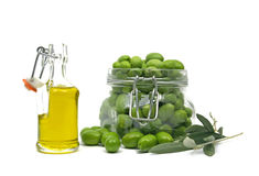 Extra virgin olive oil. And fresh green olives Royalty Free Stock Image