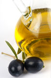 Extra virgin olive oil with black olives. Stock Image