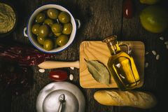 Extra virgin olive oil and food ingredients Royalty Free Stock Photo
