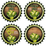 Extra Virgin Olive Oil - Four Labels. Collection of four labels with green olives and oil, text Olive oil and Extra virgin. Isolated on white background stock illustration