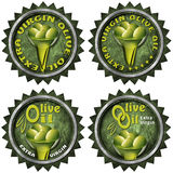 Extra Virgin Olive Oil - Four Labels. Collection of four labels with green olives and oil, text Extra virgin olive oil. Isolated on white background vector illustration