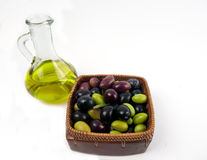 Extra virgin olive oil with fresh olives. Cold pressed, extra virgin olive oil in a decorative glass jar, from Spain, with a fresh crop of autumn picked black Stock Photography