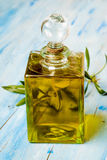 Extra virgin olive oil in glass bottle Royalty Free Stock Images