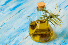 Extra virgin olive oil in glass jar Royalty Free Stock Photography