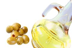 Extra-virgin olive oil and gre Royalty Free Stock Photography