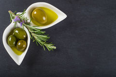Extra virgin olive oil and green olives Royalty Free Stock Photo