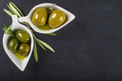 Extra virgin olive oil and green olives Stock Photo