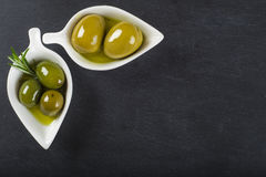 Extra virgin olive oil and green olives Royalty Free Stock Images