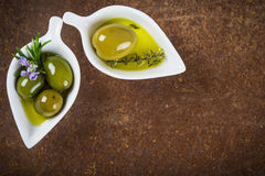 Extra virgin olive oil and green olives Royalty Free Stock Photography