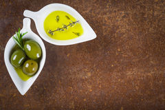 Extra virgin olive oil and green olives Royalty Free Stock Image