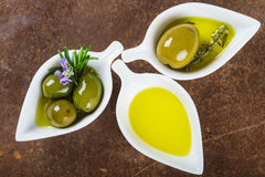 Extra virgin olive oil and green olives Stock Images