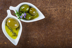 Extra virgin olive oil and green olives Stock Photography