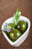 Extra virgin olive oil and green olives Royalty Free Stock Photos