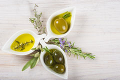 Extra virgin olive oil and green olives Stock Image