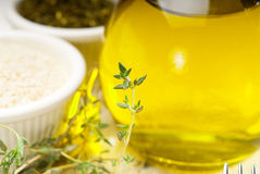 Extra virgin olive oil and herbs Stock Photos
