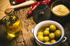 Extra virgin olive oil and olives Stock Photos