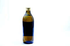 Extra virgin olive oil on plain white background. Stock Photo